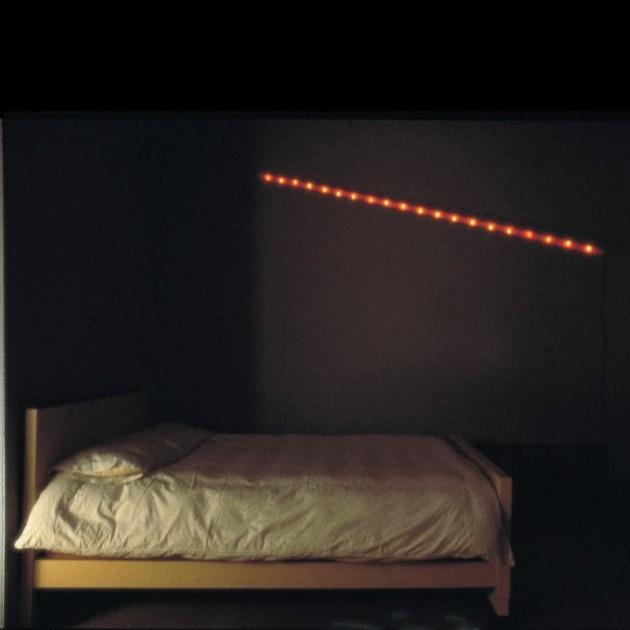 Lámpara La Colilla Santa & Cole habitación ambiente