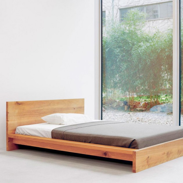 Ambiente dormitorio Cama Mo madera roble de E15 disponible en Moisés Showroom